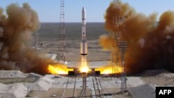 FILE - A Russian-built Proton rocket with Russian relay satellite Luch-5V and the Kazakh communication satellite KazSat-3 aboard blasts of from a launch pad in the Russian-leased Kazakhstan's Baikonur cosmodrome, April 28, 2014.