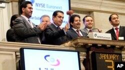 FILE - Ambassador Ali Bin Fahad Al Hajri (center) Qatari Ambassador to the U.S., rings the New York Stock Exchange closing bell, as Qatari Ambassador to the U.N. Nassir Abdulaziz Al-Nasser, gavels the market closed, Jan. 3, 2011. At left is Saif al-Mansoori, deputy CEO, Qatar Exchange.