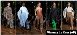Models wearing clothes from designer Stella McCartney during Paris Fashion Week on Sept. 30, 2019. For many years McCartney has been in the sustainability fight. Her latest collection uses organic cotton, recycled polyester, sustainable viscose and tracea