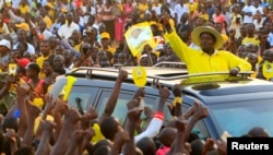 FILE - Uganda's President and the presidential candidate Yoweri Museveni of the ruling party National Resistance Movement (NRM) waves to his supporters as he arrives at a campaign rally ahead of the February 18 presidential elections in Entebbe, Uganda February