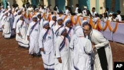 FILE - Bangladeshi Catholic nuns arrive to participate in a meeting with Pope Francis at the Church of the Holy Rosary in Dhaka, Bangladesh, Saturday, Dec. 2, 2017. (AP Photo/Aijaz Rahi)