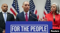 Democratic House caucus chairman Representative Hakeem Jeffries (D-NY), flanked by Rep. Colin Allred (D-TX) and Rep. Katherine Clark (D-MA), leads a news conference after a House Democratic party caucus meeting at the U.S. Capitol, Washington, U.S., Jan. 9, 2019.