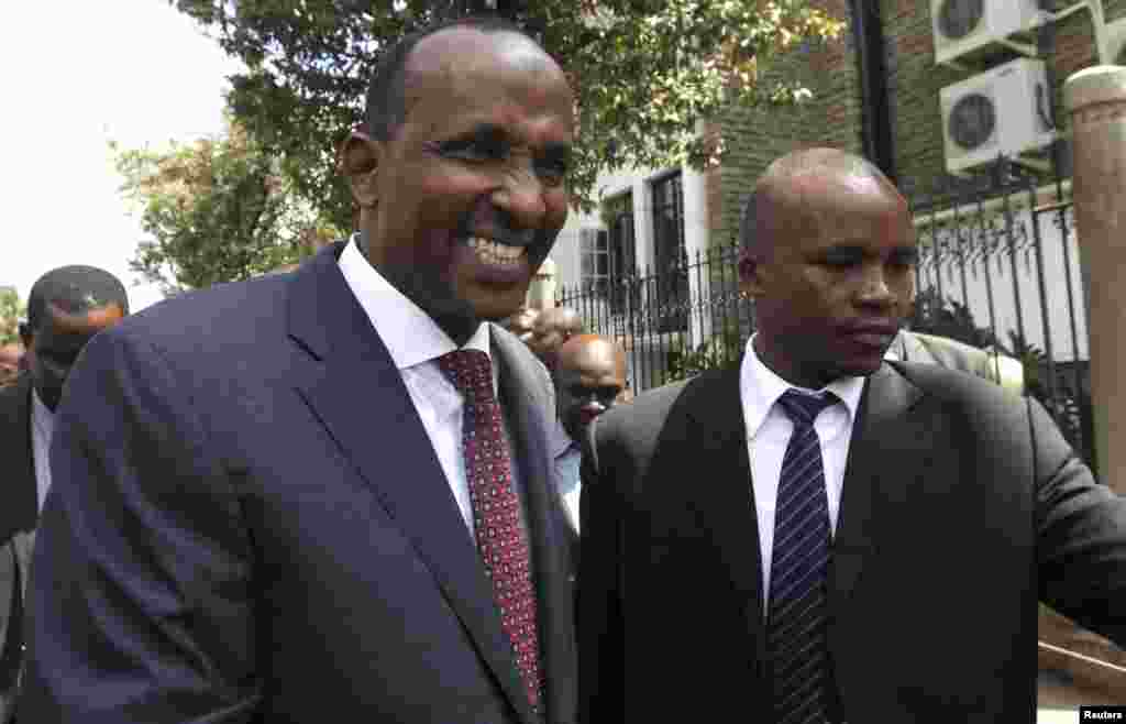 Kenya's National Assembly majority leader Aden Duale, left, is escorted out of Parliament in Kenya's capital Nairobi, Dec. 18, 2014.
