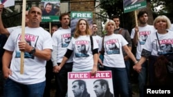 Family and friends of Greenpeace activist Kieron Bryan who is detained in Russia, protest outside the Russian Embassy in London, Oct. 5, 2013.