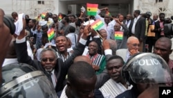 FILE - On Aug. 29, 2013, supporters celebrate the supreme court's decision to uphold the results of a presidential election outside the court in Accra, Ghana. The election of John Mahama was confirmed.