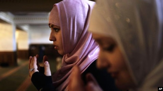 Young women pray in the Heart of Chechnya mosque during Friday Prayer