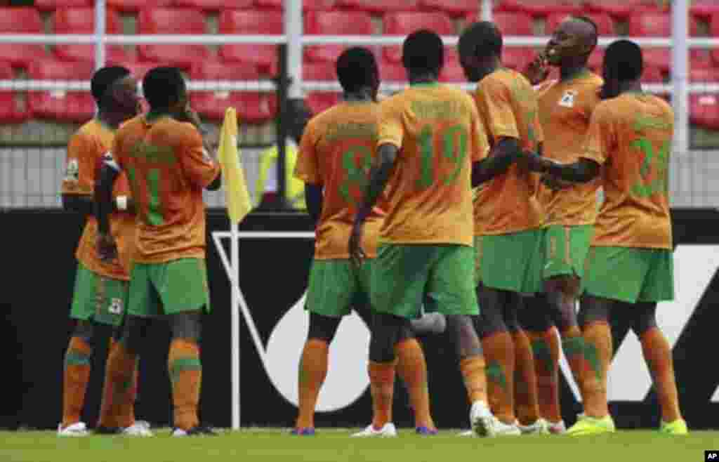 """Zambia's Stophira Sunzu (2nd R) celebrates with his teammates after scoring a goal against Sudan during their African Nations Cup quarter-final soccer match at Estadio de Bata """"Bata Stadium"""", in Bata February 4, 2012."""