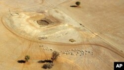 FILE- In this July 13, 2002, parched land is seen near a dry reservoir northwest of Sydney, Australia.