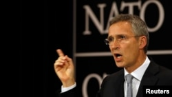 FILE - NATO Secretary General Jens Stoltenberg, shown here at a news conference in Brussels, Belgium, July 13, 2016, says going it alone on defense and security is not an option for neither the United States nor for Europe.