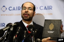 FILE - Nihad Awad, executive director of the Council on American-Islamic Relations, pictured at a Washington news conference in September 2010, says those who think U.S. laws contradict Islamic teachings are misguided.