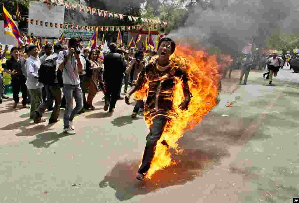 March 26: Tibetan exile Jamphel Yeshi screams as he runs after setting himself on fire at a protest in New Delhi, India.