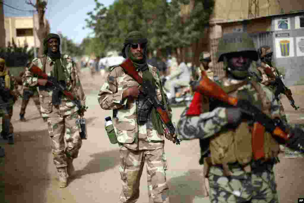 Chadian soldiers patrol the streets of Gao, Mali, January 29, 2013.