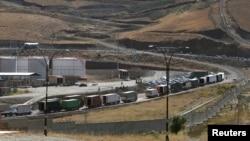 Trucks are seen at Haj Omran border, on the border between Iran and Kurdistan, Iraq, Oct. 14, 2017.