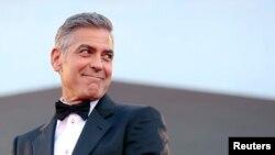 "Aktor Amerika George Clooney dalam acara penayangan perdana film ""Gravity"" di Festival Film Venice, 2013."