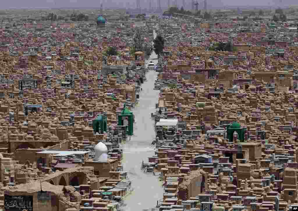 """A view of the Wadi al-Salam, or """"Valley of Peace"""" cemetery in the Shiite holy city of Najaf, 160 kilometers south of Baghdad, Iraq, July 1, 2014."""