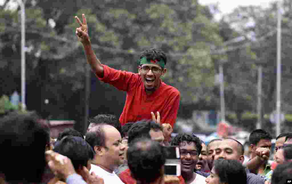 An activist celebrates the verdict against Jemaat-e-Islami party leader Abdul Quader Mollah in Dhaka, Sept. 17, 2013.