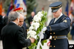 Afghan leaders Abdullah Abdullah, left, and Ashraf Ghani lay a wreath at the Tomb of the Unknowns at Arlington National Cemetery in Arlington, Va., March 24, 2015.