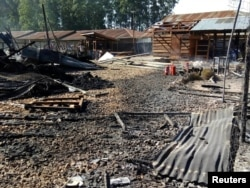 Burned structures are seen after attackers set fire to an Ebola treatment center run by Medecins Sans Frontieres (MSF) in the east Congolese town of Katwa, Democratic Republic of Congo, Feb. 25, 2019. Picture taken February 25, 2019. (Laurie Bonnaud/MSF)