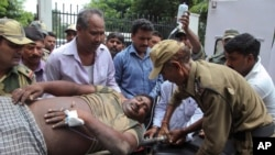 An Indian Border Security Force soldier injured in exchange of fire on the India Pakistan border is brought for treatment at the government medical college hospital in Jammu, India, July 15, 2015.