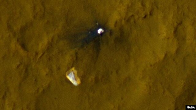 This color view of the parachute and back shell that helped deliver NASA's Curiosity rover to the surface of the Red Planet was taken by the High-Resolution Imaging Science Experiment (HiRISE) camera on NASA's Mars Reconnaissance Orbiter.