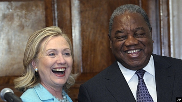 Secretary of State Hillary Rodham Clinton and Zambia's President Rupiah Banda share a laugh following their press availability at the State House in Lusaka, Zambia, Friday, June 10, 2011