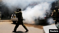 Policemen fire tear gas to disperse opposition supporters protesting against the retention of the election officials they blame for last month's botched elections, in Nairobi, Oct. 2, 2017.