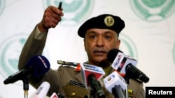 FILE - Interior Ministry spokesman Mansour Turki gestures during a news conference in Riyadh.