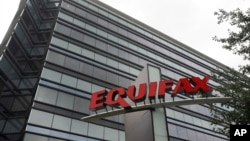 FILE - The offices of Equifax, one of three major consumer credit reporting companies in the U.S., offices are seen in Atlanta, Georgia, July 21, 2012. The company's CEO, Richard Smith, resigned Tuesday following a massive data breach.
