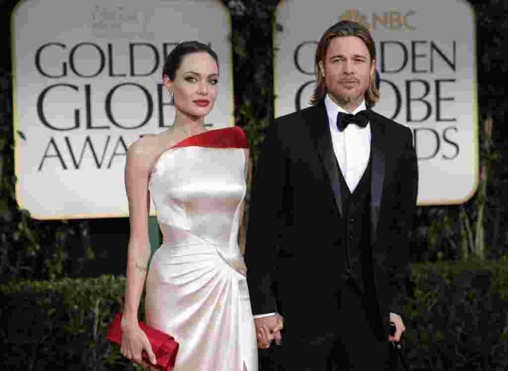 """Mejor Actor: Brad Pitt por """"El juego de la fortuna"""" (Moneyball)."""