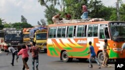 Activists of Bangladesh's Jamaat-e-Islami party vandalize buses after the Bangladesh high court disqualified the party from taking part in the next general election in Bogra, north of Dhaka, August 1, 2013.