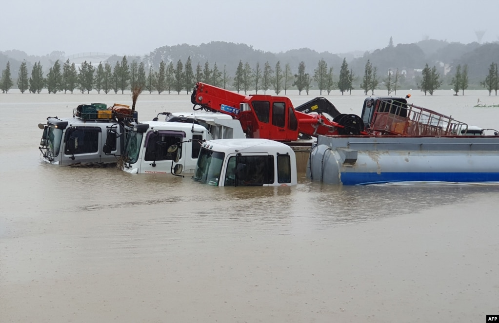 Trucks and vehicles are seen in floodwaters from heavy rains caused by Typhoon Mitag in Gangneung, South Korea.