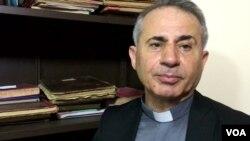 Father Najeeb Michael (VOA/ S. Behn)