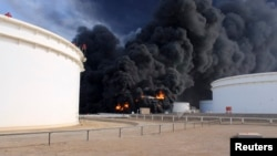Smoke rises from an oil tank fire in Es Sider port, Libya, Dec. 26, 2014.