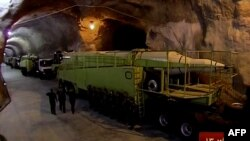 This image from an Oct. 14, 2015, broadcast on the Islamic Republic of Iran News Network reportedly shows missile launchers in an underground tunnel at an unknown location in Iran.