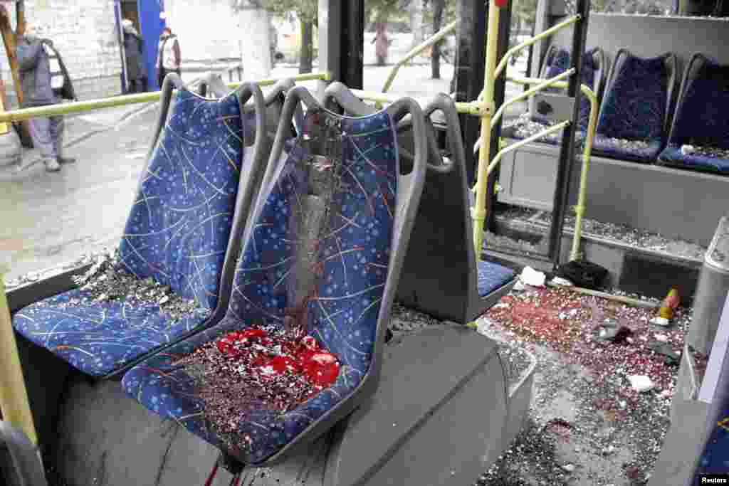 An interior view shows a damaged bus, hit by mortar fire. A Reuters cameraman said he saw six bodies on the ground near and inside the bus, Donetsk, Jan. 22, 2015.