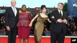 Director Guillermo Del Toro, from right, actors Sally Hawkins, Octavia Spencer and Richard Jenkins pose for photographers upon arrival at the premiere of the film 'The Shape of Water' Aug. 31, 2017.