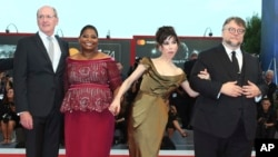 "FILE - Director Guillermo Del Toro, from right, actors Sally Hawkins, Octavia Spencer and Richard Jenkins pose for photographers upon arrival at the premiere of the film ""The Shape of Water"" during the 74th edition of the Venice Film Festival in Venice, I"