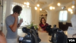 VOA Ukrainian journalist Tatiaia Koprowicz during the filming of the hit TV show Anektody po-Ukrainsky