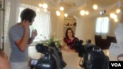 VOA Ukrainian journalist Tatiaia Koprowicz during the filming of the hit TV show Anektody po-Ukrainsky