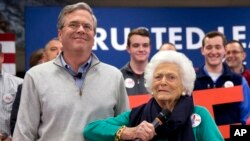Barbara Bush jokes with her son, Republican presidential candidate Jeb Bush, while introducing him at a town hall meeting at West Running Brook Middle School in Derry, N.H., Feb. 4, 2016.