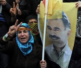 A person holds a poster of jailed Kurdish rebel leader Abdullah Ocalan as Kurdish demonstrators march in Istanbul, Turkey, April 19, 2011