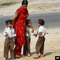 Shreejana Thapa accompanies her daughters after school at Naubise village near Kathmandu (File)