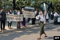 A group of protestors hold a demonstration in Mandalay on Feb 4, 2021 after a lightning coup brought a country on the path to democracy to a shuddering halt, returning the reins of power to the military who ruled Myanmar with an iron fist for nearly five