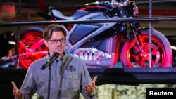 "Mark-Hans Richer, the chief marketing officer of Harley Davidson, speaks in front of an electric Harley Davidson motorcycle that is part of the ""Project Livewire"" in the company's store in New York, June 23, 2014"