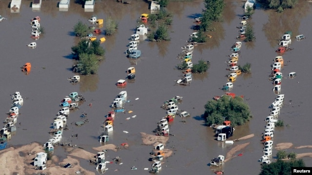 Rows of vehicles lie flooded as search-and-rescue teams fanned out across Colorado. Sept. 17, 2013.