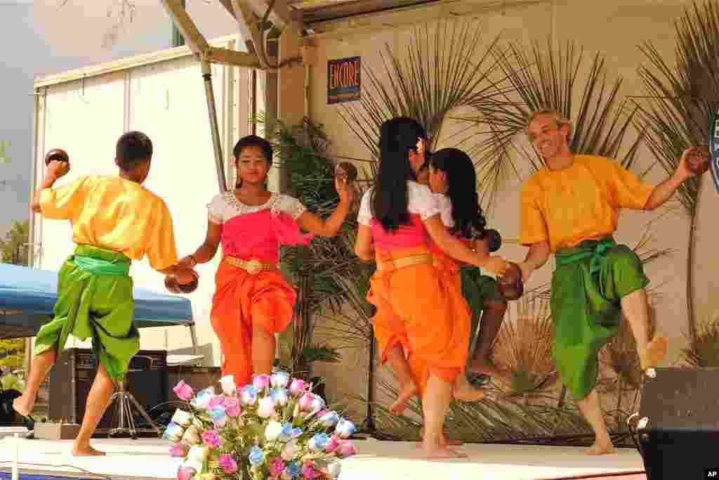 Geoffrey Nelson and his Cambodian colleagues dance Robaim Kuos Tralauk, a popular traditional Khmer dance, which is often translated as 'Coconut Dance.'