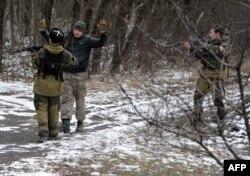 Pro-Russian separatists question a man in the eastern Ukrainian city of Vuhlehirsk, six kilometers southwest of Debaltseve, Feb. 19, 2015.