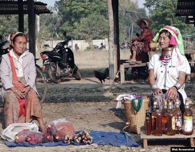 Elderly women from the Padaung tribe sell home-made honey in dis-used whiskey bottles.
