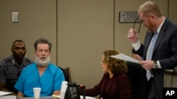 Robert Lewis Dear glares at his attorney, Daniel King, during an outburst at his court appearance in Colorado Springs, Colorado, Dec. 9, 2015.