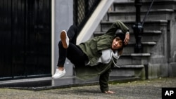 B-Girl Ayumi is a teacher by day but a world-class breakdancer by night. She poses here on October 31st 2017 (Little Shao/Red Bull Content Pool via AP Images)